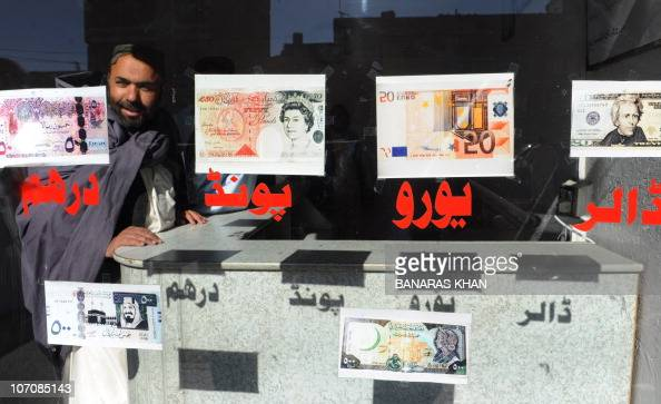A Pakistani man waits for the customers at his currency exchange shop in Quetta on November 22 2010 The European single currency and stock markets...
