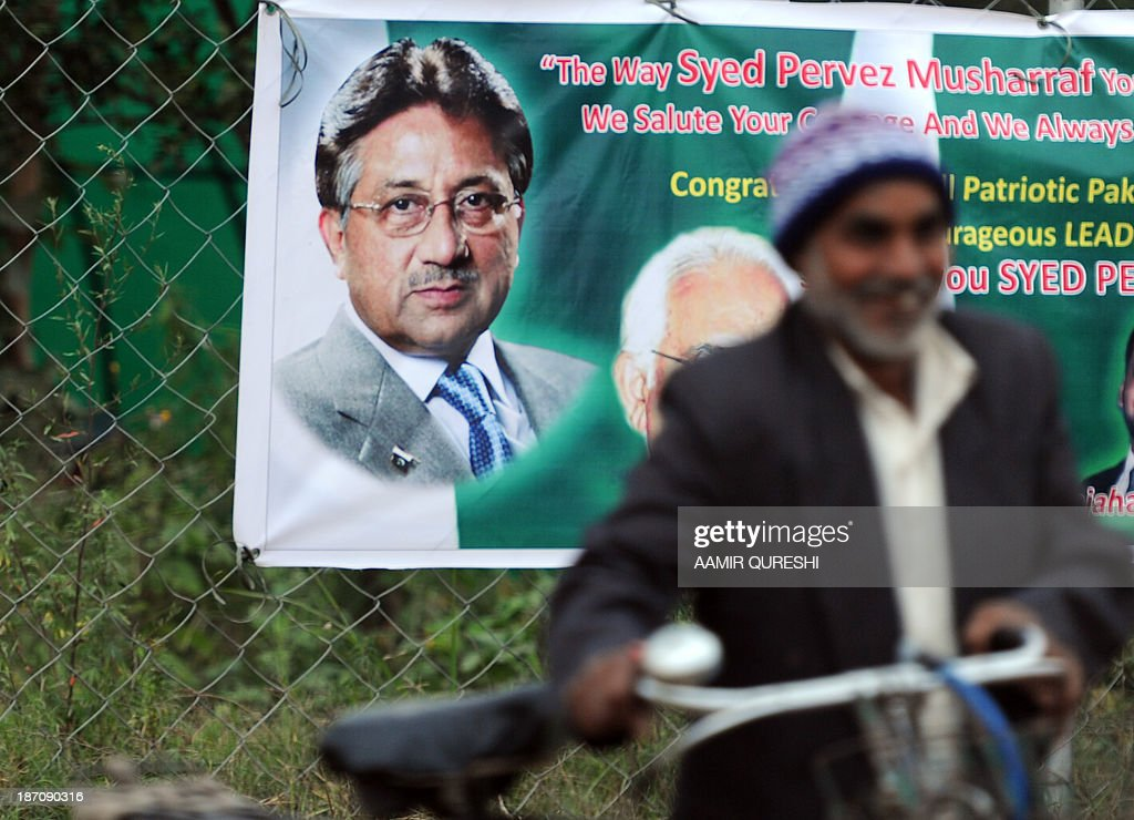 A Pakistani man walks past a banner showing an image of former Pakistani military ruler Pervez Musharraf near his residence in Islamabad on November 6, 2013. A Pakistan court granted bail to former military ruler Pervez Musharraf over a deadly raid on a radical mosque, bringing closer his possible release after more than six months of house arrest. The ruling by an Islamabad district court means the ex-general is on bail in all the cases brought against him since his return to Pakistan from self-imposed exile, including one relating to the assassination of former prime minister Benazir Bhutto. But the 70-year-old is likely to remain under heavy guard at his villa on the edge of Islamabad, where he has been under house arrest since April, because of serious threats to his life.