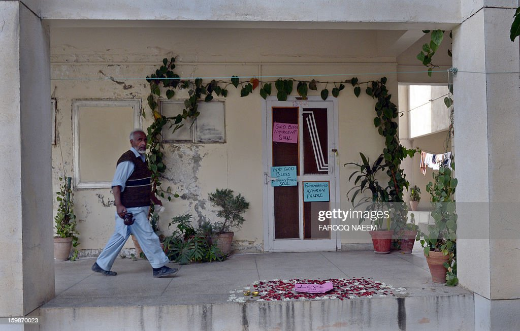 A Pakistani man walks past the room formerly occupied by Kamran Faisal, who was investigating a corruption scandal involving Prime Minister Raja Pervez Ashraf and who was found dead in a government hostel, in Islamabad on January 22, 2013. Pakistan's anti-corruption watchdog Monday said it had suspended a probe into a graft scandal involving the prime minister pending an inquiry into the death of an officer investigating the case. AFP PHOTO/Farooq NAEEM