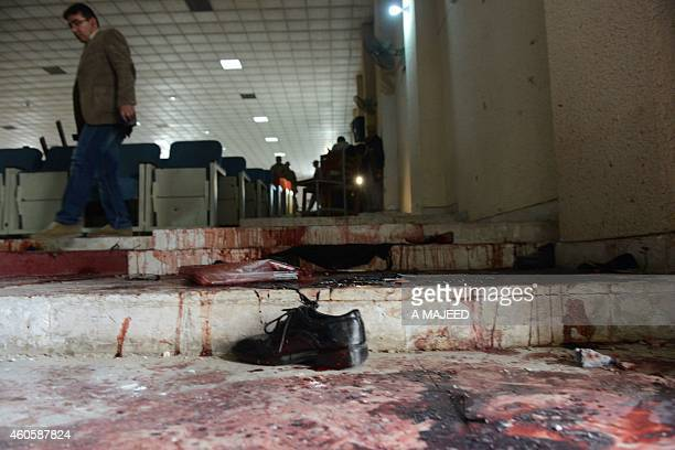 A Pakistani media person walks in the bloodied ceremony hall at an armyrun school a day after an attack by Taliban militants in Peshawar on December...
