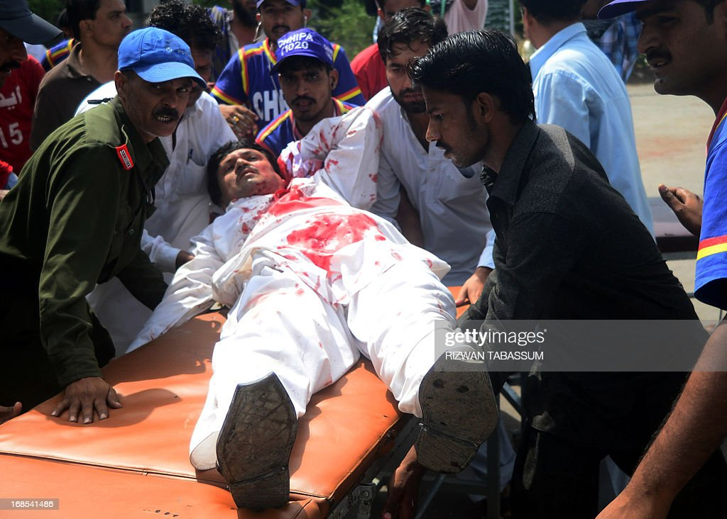 Pakistani men push a stretcher carrying an injured blast victim to a hospital following a bomb explosion in Karachi on May 11, 2013. A Taliban bomb attack targeting an election candidate killed at least 11 people and wounded 36 others in Pakistan's financial hub of Karachi as polls got under way, a doctor said. The bomb targeted a candidate seeking election to the Sindh provincial assembly for the Awami National Party (ANP), the main secular party for ethnic Pashtuns, police said.