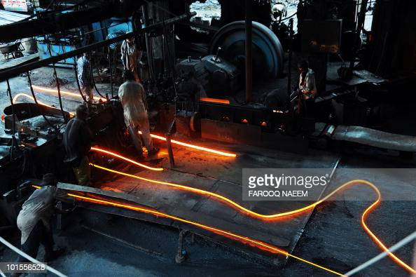 Pakistani metal labourers work at a forge in an industrial area of Islamabad on April 30 2010 Labour Day will be observed globally commemorated in...