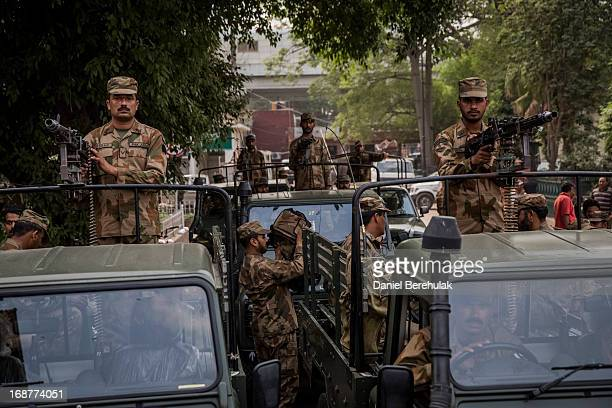 Pakistani Military soldiers oversee the delivery and unloading of ballot boxes and papers on May 10 2013 in Lahore Pakistan Pakistan's parliamentary...