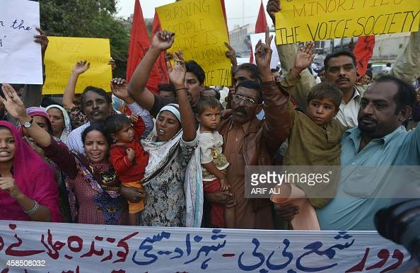 Pakistani minority Christians chant slogans protesting the murder of a Christian couple in Lahore on November 6 2014 A Pakistani Christian bonded...