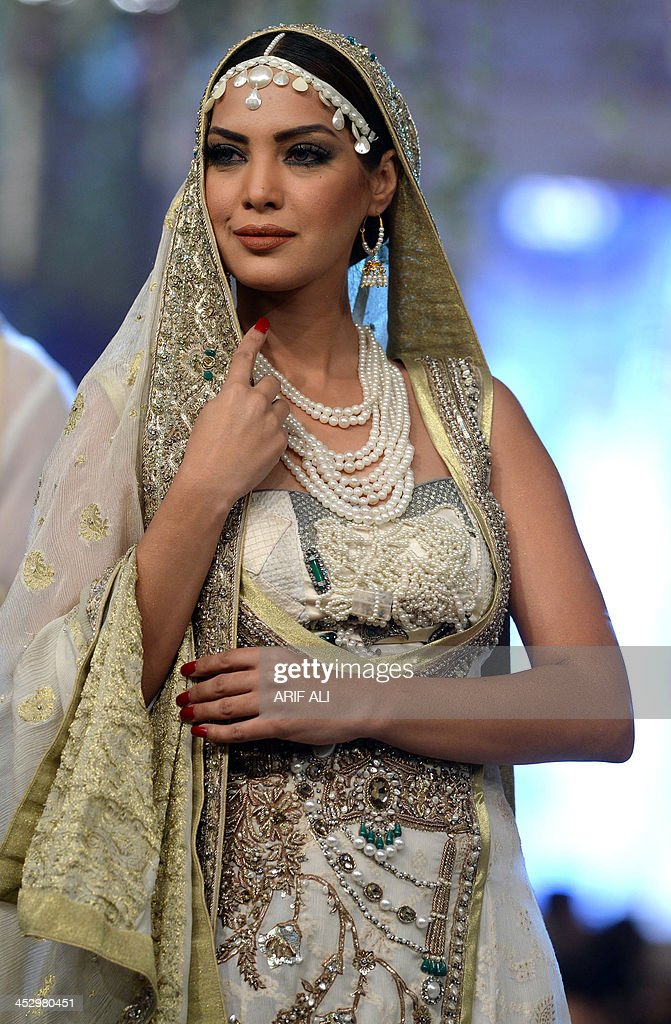 A Pakistani model presents a creation by designer Zahid Khan on the last day of the 'Pantene Bridal Couture Week 2013' in Lahore on late December 1, 2013. AFP PHOTO/Arif ALI