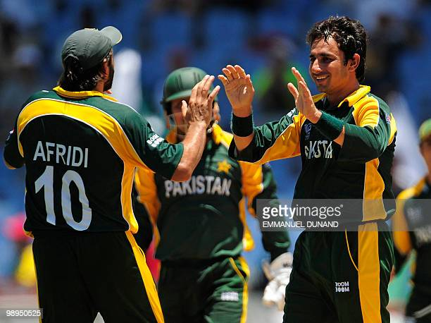 Pakistani Mohammad Aamer and captain Shahid Afridi celebrate the dismissal of South African batsman Mark Boucher during the ICC World Twenty20 Super...