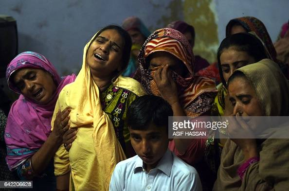 Pakistani mother mourns along with others over the coffin of her son 13yearold blast victim Zeeshan during his funeral in the town of Sehwan in Sindh...