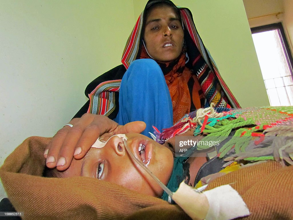 A Pakistani mother tends to her young son suffering from measles at a Red Cross hospital in the southern Sindh province city of Sukkur on January 1, 2013. More than 300 Pakistani children died of measles last year, a staggering increase on the previous 12 months and a result of three consecutive years of flooding, officials said. The United Nations' World Health Organization said 306 children died of the highly infectious illness last year, 210 of them in the southern province of Sindh, where the worst floods occurred in 2010, 2011 and 2012.