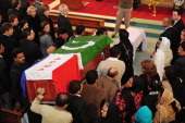 Pakistani mourners carry the coffin of slain minister Shahbaz Bhatti into the Fatima Church for the funeral ceremony in Islamabad on March 4 2011...