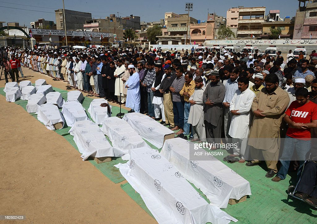 Pakistani mourners perform funeral prayers for garment factory fire victims, their bodies released by authorities after months of forensics investigations following their deaths in the incident September last year, during a funeral in Karachi on February 24, 2013. Pakistani police have moved to drop murder charges against the owners of a garment factory where 289 workers were killed in a fire in September 2012, the mens' lawyer said February 11. AFP PHOTO/Asif HASSAN