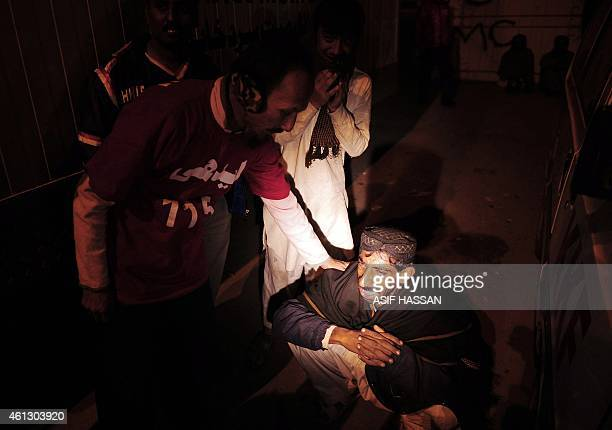 Pakistani mourners react outside a hospital in Karachi early on January 11 following an accident between a passenger bus and an oil tanker along the...