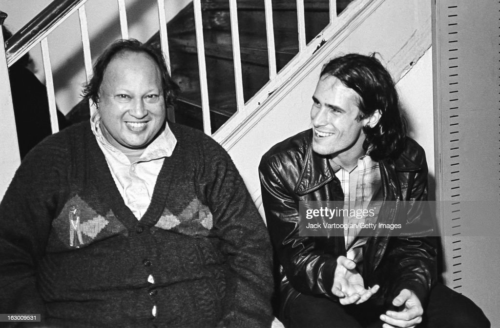 Pakistani musician Nusrat Fateh Ali Khan (1948 - 1997) (left) shares a laugh with American musician Jeff Buckley (1966 - 1997) backstage after Khan's World Music Institute concert at Town Hall, New York, New York, October 7. 1995.