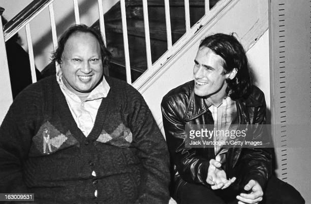 Pakistani musician Nusrat Fateh Ali Khan shares a laugh with American musician Jeff Buckley backstage after Khan's World Music Institute concert at...