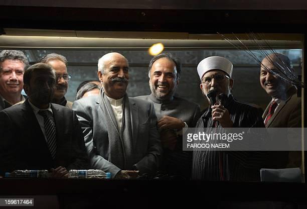Pakistani Muslim cleric Tahirul Qadri addresses supporters after signing an ageement with ruling coallition leaders Qamar Zaman Kaira and Khursheed...