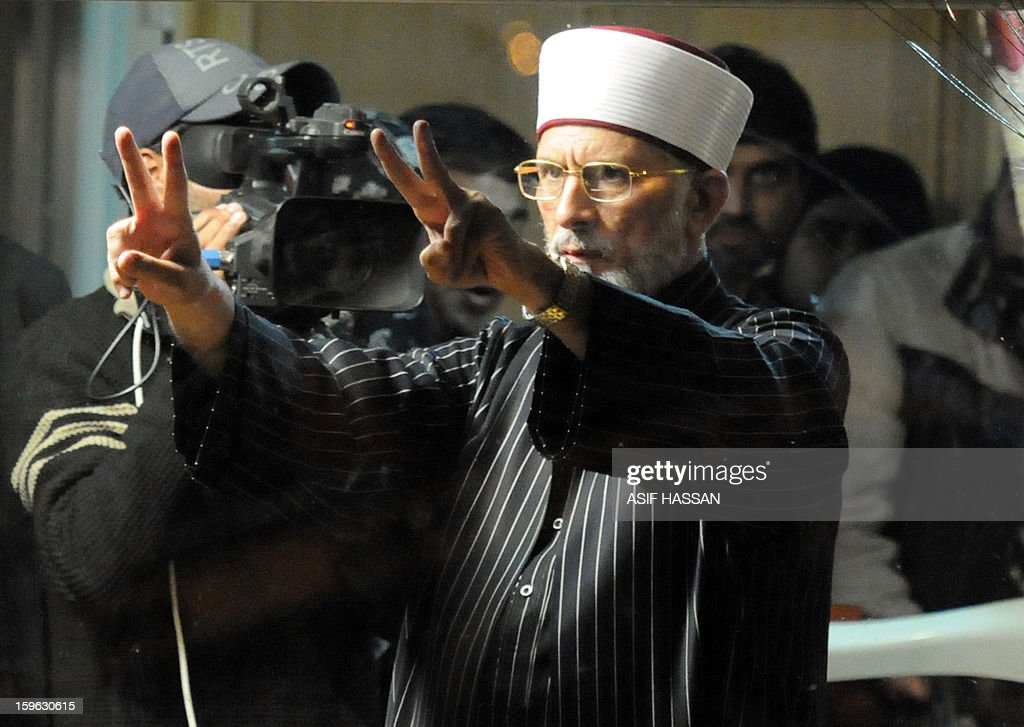 Pakistani Muslim cleric Tahir-ul Qadri flashes victory signs during a protest rally in Islamabad on January 17, 2013. A populist Pakistani cleric calling for electoral reforms announced that a mass sit-in of tens of thousands of people camped outside parliament in Islamabad would end today. Qadri wants parliament dissolved and a caretaker government set up in consultation with the military and judiciary to implement key reforms before free elections can be held. AFP PHOTO / Asif HASSAN