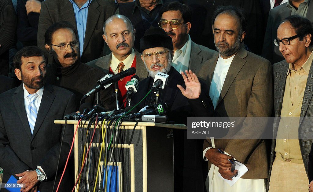 Pakistani Muslim cleric Tahir-ul Qadri (C) watched by ruling coallition leaders addresses press conference following a meeting in Lahore on January 27, 2013. Pakistan's government on Sunday said it would aim to announce a date for a general election within 10 days, following talks with a cleric who led a mass four-day protest in the capital. AFP PHOTO/Arif ALI