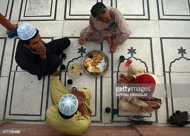 Pakistani Muslim devotees pray before breaking their fast during the Muslim fasting month of Ramadan in Karachi on June 19 2015 Islam's holy month of...