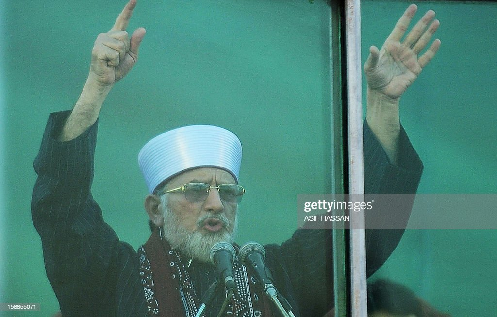 Pakistani Muslim scholar Tahir-ul Qadri (C) addresses supporters of the Muttahida Qaumi Movement (MQM) political party, during a public rally in Karachi on January 1, 2013. A motorcycle bomb exploded Tuesday near the venue of a major political rally in Pakistan's largest city Karachi, killing two people and injuring 25 others, police said. The bombing appeared to be targeted at buses carrying supporters of the city's dominant political party, the Muttahida Qaumi Movement (MQM), which organised the rally attended by thousands of people.
