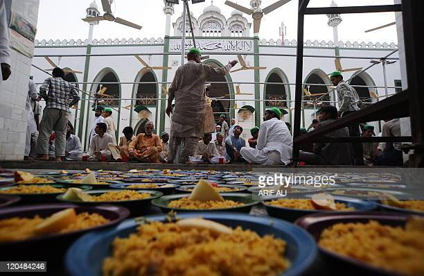 Pakistani Muslim wait before breaking their fast during the Muslim holy month of Ramadan in Lahore on August 6 2011 Ramadan in Pakistan the world's...