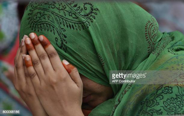 Pakistani Muslim woman offers prayers on the last congregational Friday prayers of the holy month of Ramadan ahead of the Muslim festival of Eid...