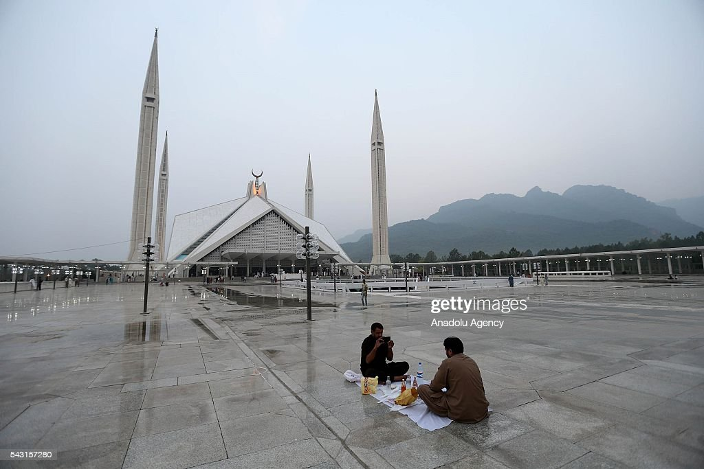Pakistani muslims break their fast during the holy fasting month of Ramadan at Faisal Mosque in Islamabad, Pakistan on June 26, 2016.
