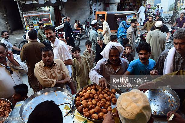 Pakistani Muslims buy iftar food before breaking their fast during the Muslim fasting month of Ramadan in Rawalpindi on June 19 2015 Islam's holy...