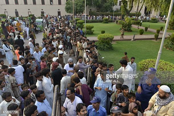 Pakistani Muslims gather for iftar food before breaking their fast during the Muslim fasting month of Ramadan in Lahore on June 21 2015 Islam's holy...