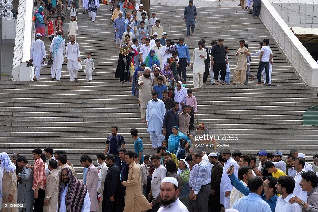 Pakistani Muslims leave the grand Faisal Mosque after offering Jummat-ul-Vida, the last congregational Friday prayers in the holy month of Ramadan at a mosque in Karachi on July 1, 2016. Muslim devotees took part in the last Friday prayers ahead of the Eid al-Fitr festival marking the end of the fasting month of Ramadan, which is dependent on the sighting of the moon. / AFP / AAMIR