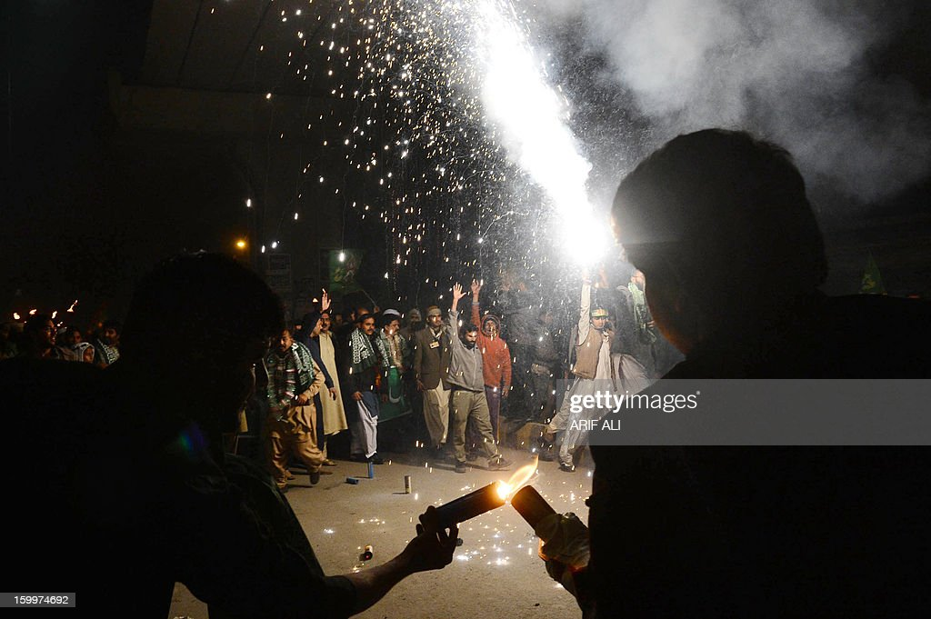 Pakistani Muslims light fireworks as they celebrate on the eve of Eid Milad-un-Nabi, the birth of the Prophet, in Lahore on January 24, 2013. Pakistani Muslims will celebrate the birth of the Prophet Mohammed on January 25. AFP PHOTO/ Arif ALI