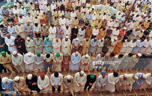 Pakistani Muslims offer Friday prayers at mosque during the month of Ramadan in Lahore on July 19 2013 Islam's holy month of Ramadan is calculated on...