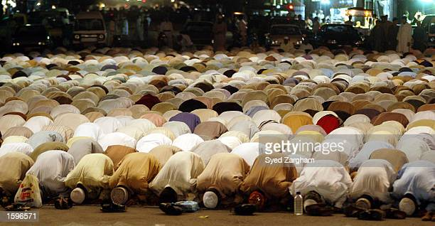 Pakistani Muslims offer Ramadan prayers at a local mosque on the first day of the Muslim holy month of Ramadan November 7 2002 in Karachi Pakistan...