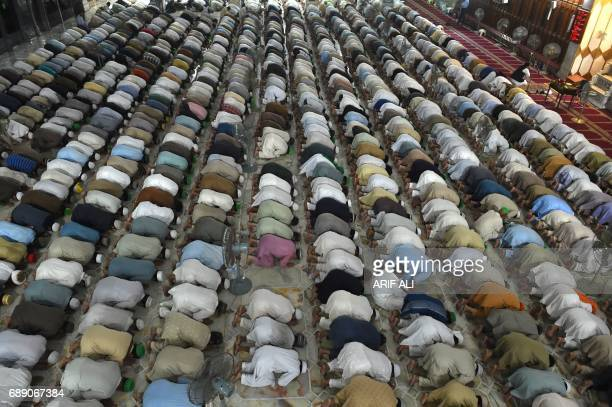 Pakistani Muslims perform a special taraweeh prayer on the start of the holy month of Ramadan on May 27 2017 at a mosque in Lahore The world's nearly...
