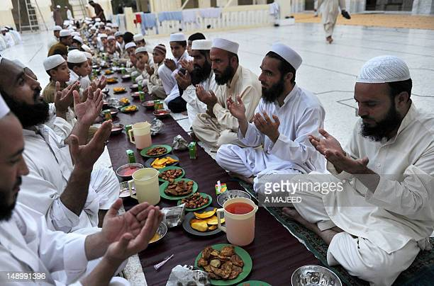 Pakistani Muslims pray before breaking their fast in Peshawar on July 21 on the first day of Muslims fasting month of Ramadan Muslims fasting in the...