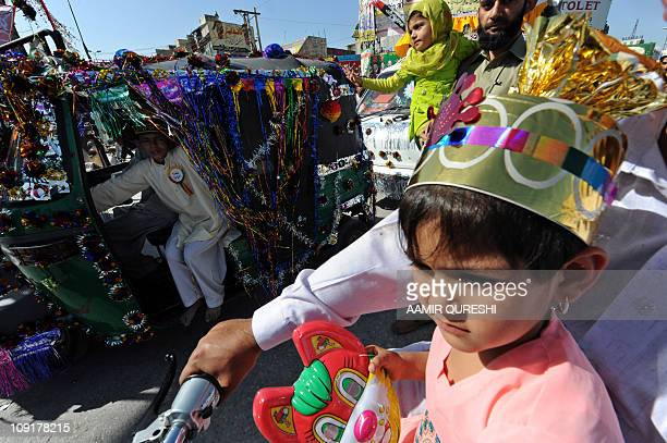 Pakistani Muslims sit their decorated vehicles as they march during celebrations marking EideMiladunNabi the birth of Islam's Prophet Mohammed in...