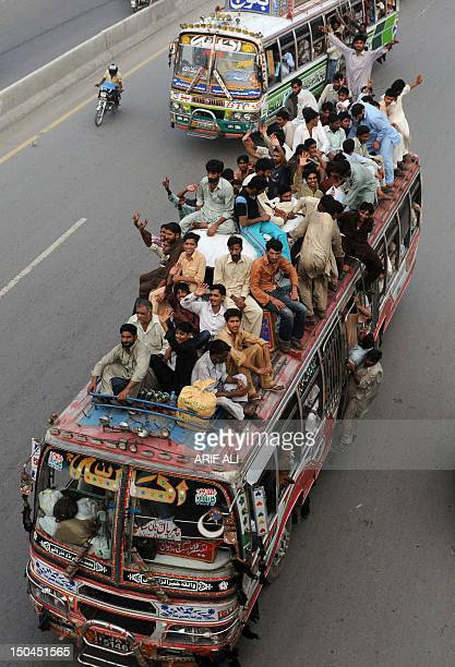 Pakistani Muslims travel on an overloaded bus as they head to their hometowns ahead of the Muslim festival of Eid alFitr in Lahore on August 18 2012...