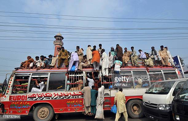 Pakistani Muslims travel on an overloaded bus as they head to their hometowns ahead of the Muslim festivities of Eid alFitr in Lahore on August 7...