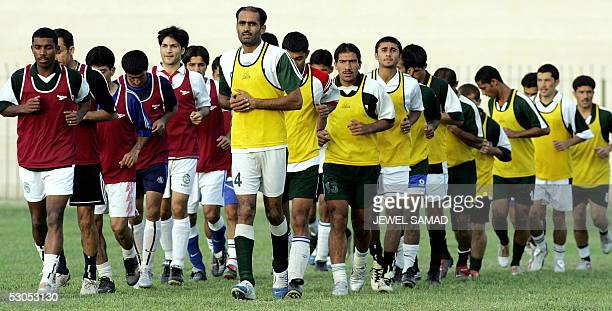 Pakistani national football team players run during a practice session at the Ayub Stadium in Quetta 11 June 2005 on the eve of their first match...