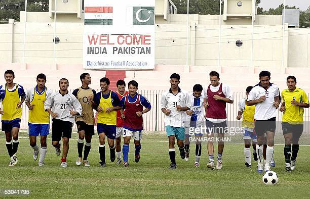Pakistani national team footballers run during a practice session in Quetta 09 June 2005 The first ever football series between South Asian...