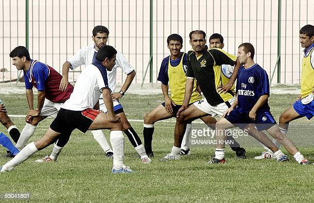 Pakistani national team footballers stretch during a practice session in Quetta 09 June 2005 The first ever football series between South Asian...