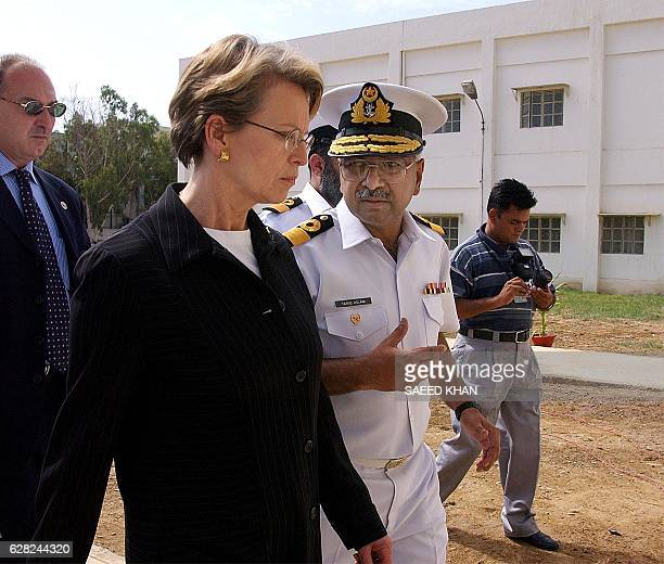Pakistani Naval officer Tariq Aslam escorts French Defence Minister Michele AlliotMarie to see the dead bodies of the French naval workers killed in...