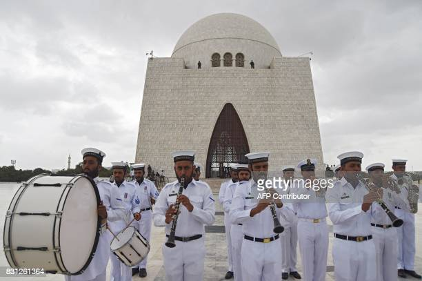 Pakistani Navy band members perform during a ceremony at the mausoleum of Pakistan's founder Mohammad Ali Jinnah to mark the country's Independence...