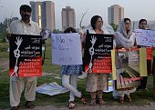 Pakistani NGO activists carry placards during a demonstration to mark the International Day Against the Death Penalty in Islamabad on October 10 2014...
