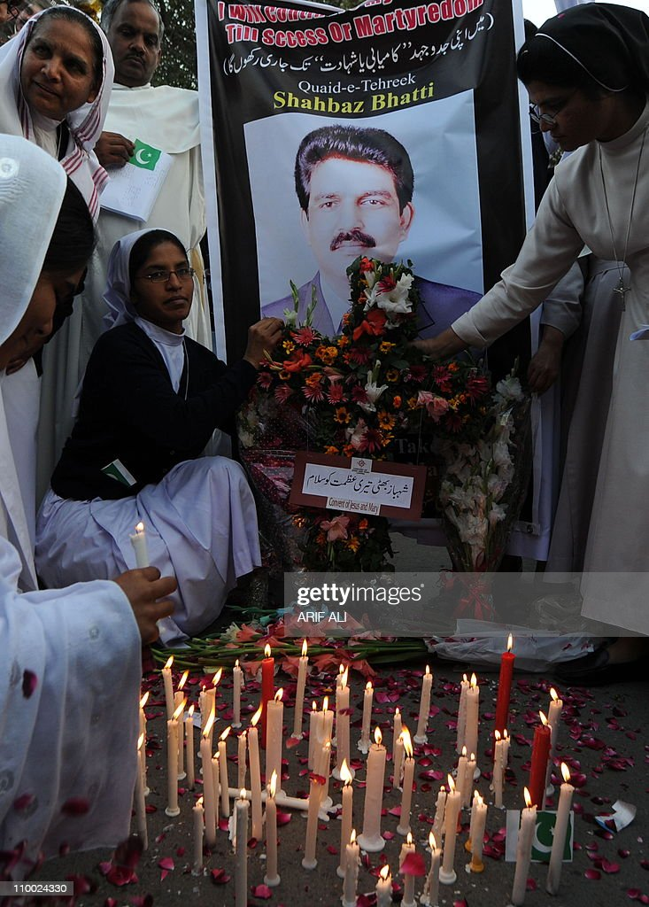 Pakistani nuns light candle during a rally in Lahore on March 12, 2011, for the slain Pakistani Minority affairs minister Shahbaz Bhatti. Bhatti, 42, an outspoken campaigner against Pakistan's Islamic blasphemy laws that carry the death penalty, was killed by Taliban militants as he left his family home in Islamabad on March 2. AFP PHOTO/Arif ALI