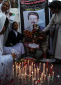 Pakistani nuns light candle during a rally in Lahore on March 12 for the slain Pakistani Minority affairs minister Shahbaz Bhatti Bhatti an outspoken...
