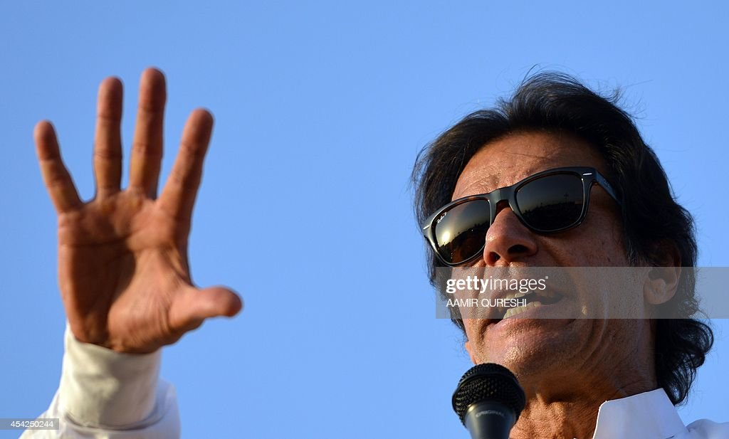 Pakistani opposition politician Imran Khan addresses supporters during an anti-government protest in front of the Parliament in Islamabad on August 27, 2014