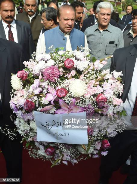Pakistani ousted prime minister Nawaz Sharif arrives at the tomb of Pakistan's national poet Allama Mohammad Iqbal to mark the country's Independence...