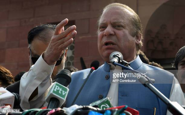 Pakistani ousted prime minister Nawaz Sharif speaks with media representatives at the tomb of Pakistan's national poet Allama Mohammad Iqbal to mark...