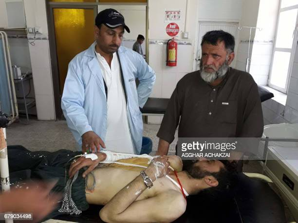 A Pakistani paramedic gives treatment to an injured victim at a hospital following cross border firing in the border town of Chaman on May 5 2017...