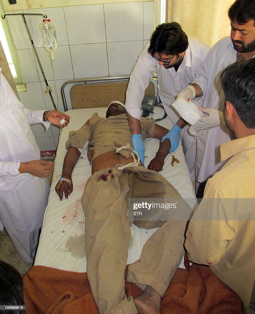 Pakistani paramedics give treatment to an injured blast victim at a hospital following a bomb explosion on the outskirts of Dera Ismail Khan in Khyber Pakhtunkhwa province on November 24, 2012. A bomb exploded near a Shiite religious procession in northwest Pakistan on November 24 killing seven people including four children, hospital officials said. The blast went off as people from the minority Shiite Muslim community were gathering to mark the anniversary of the death of the Prophet Mohammed's grandson Imam Hussain in 680.