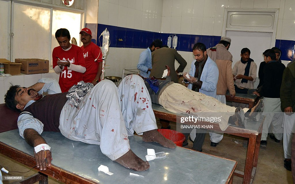 Pakistani paramedics give treatment to injured Shiite Muslim pilgrims at a hospital following a car bomb attack in Quetta on December 30, 2012. A car bomb attack on buses carrying Shiite Muslim pilgrims to Iran killed 19 people and injured 25 in Pakistan's insurgency-hit southwest on December 30, officials said.